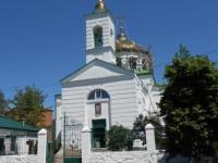 Дзвінниця Хрестовоздвиженського (Миколаївського) храму прикрашена  художньою решіткою