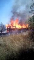 В Ізюмі інспектори ДАІ гасили пожежу